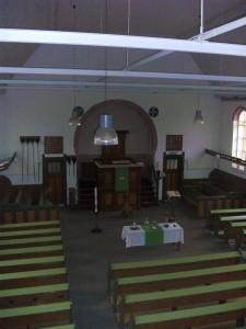 Het interieur van de kerkzaal (foto: Reliwiki).